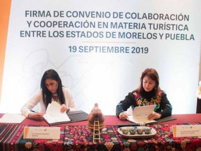 """<a href=""""/noticias/firman-convenio-morelos-y-puebla-en-materia-turistica"""">Firman convenio Morelos y Puebla en materia turística</a>"""